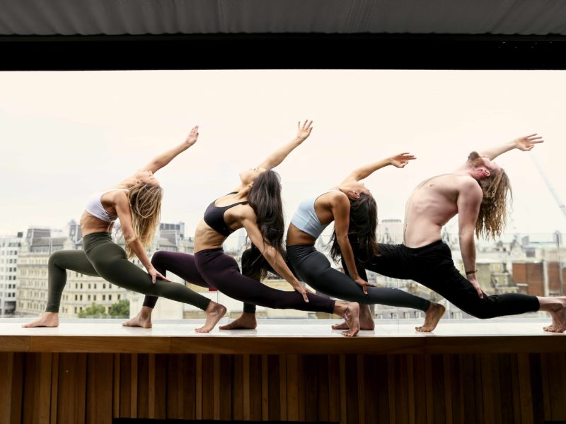 Kxu x trafalgar rooftop yoga sunrise series
